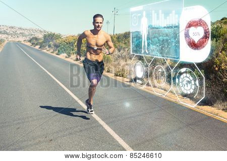 Athletic man jogging on open road with monitor around chest against fitness interface