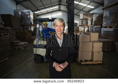 Manager standing in front of her employee in a large warehouse
