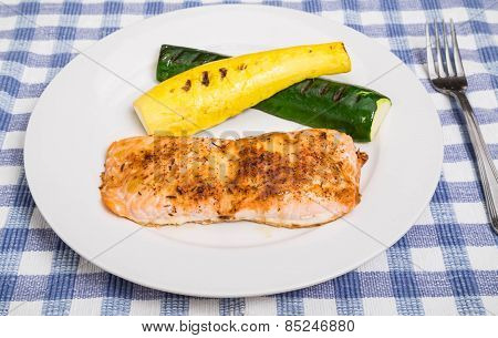 Salmon With Squash On White Plate