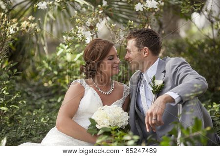 Newly married couple having private moment together in garden