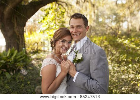 Beautiful newly married couple together in garden