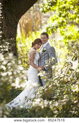 New bride and groom together in the garden