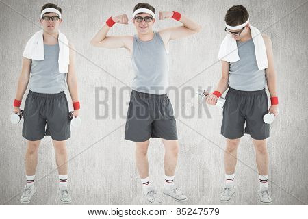 Nerd working out against white and grey background
