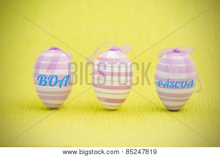 boa pascua against purple easter eggs standing