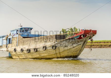 PHNOM PENH, CAMBODIA, JANUARY 2, 2013: Big fishing boat on the Bassac River