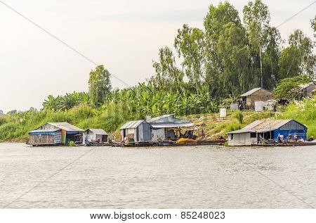PHNOM PENH, CAMBODIA, JANUARY 2, 2013: Floating village and fishing boats mooring at the riverside of Bassac River