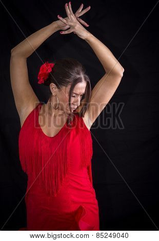 Flamenco Dancer Backs Red Dress And Hands Crossed Up On His Back On Black Background
