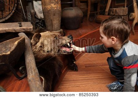 Child And Stuffed Bear