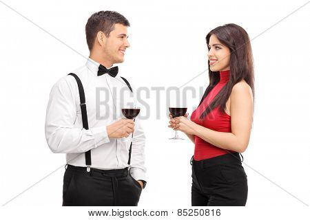 Couple drinking red wine and talking to each other isolated on white background