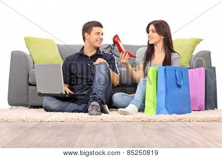 Woman showing her new shoes to her boyfriend isolated on white background