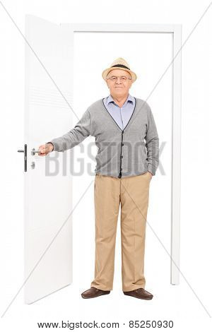 Full length portrait of a senior entering a room isolated on white background