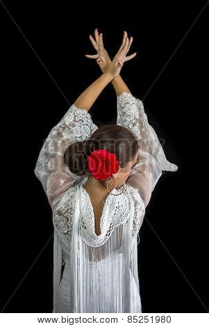 Flamenco Dancer Backs With White Dress And Hands Crossed Up On His Back On Black Background