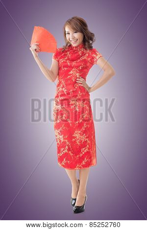 Attractive Chinese woman dress traditional cheongsam and hold red envelope, closeup portrait.
