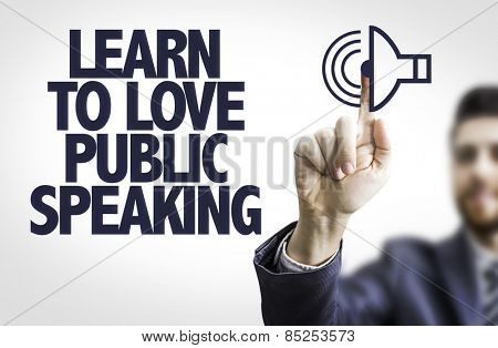 Business man pointing the text: Learn to Love Public Speaking