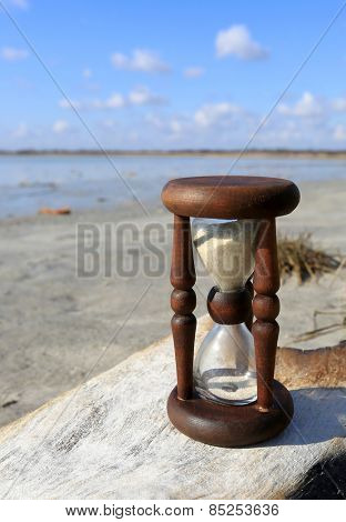 Hourglass on wood in a outdoor