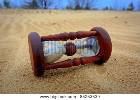 Abstract hourglass on sand surface