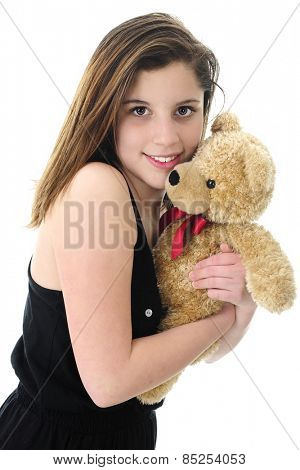 Closeup image of a beautiful teen brunette hugging a generic tan teddy bear.  On a white background.