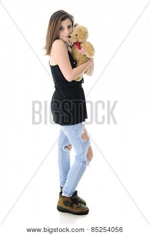 A beautiful teen girl lovingly hugging a generic tan Teddy Bear.  On a white background.