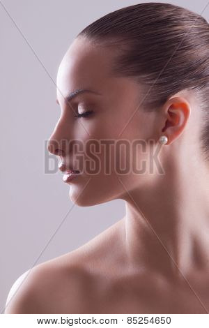 Portrait of young beautiful woman with perfect healthy skin