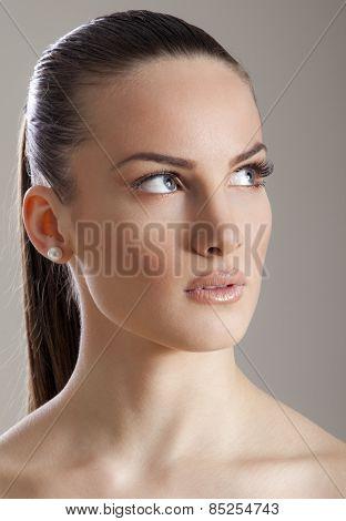 Beautiful girl looking up