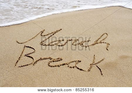 the text march break written in the sand of a beach