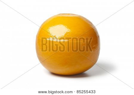 Whole yellow round Edam cheese on white background
