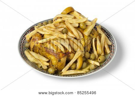 Traditional moroccan stuffed chicken with french fries on white background
