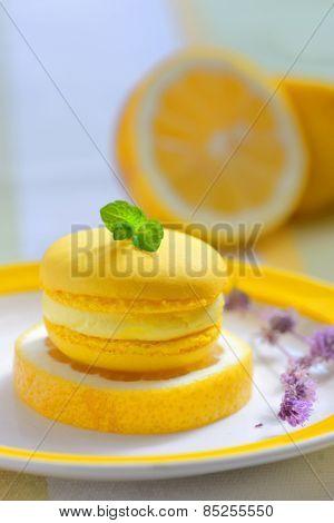 yellow lemon macaron and lemons