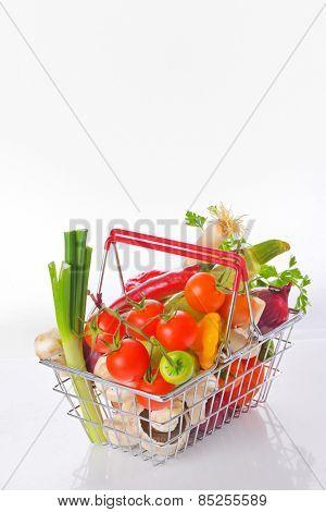 Assortment of fresh vegetables in basket