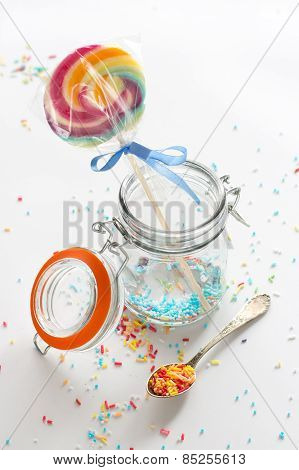 candy - colorful sugar sprinkles and a lollipop