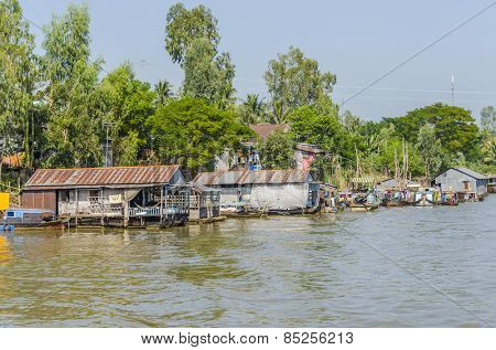 CHAU DOC, VIETNAM - JANUARY 2, 2013: Rural life in Mekong delta- Floating village and fishing boats mooring at the riverside of Bassac River