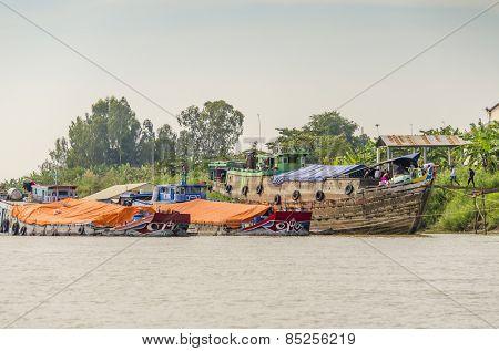 PHNOM PENH, CAMBODIA, JANUARY 2, 2013: Mekong delta - Floating village and fishing boats mooring at the riverside of Bassac River