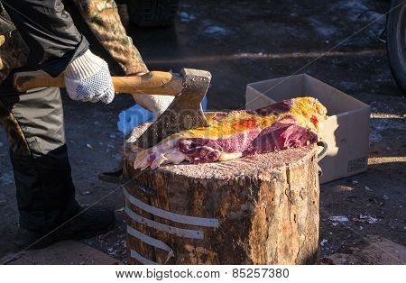 A Butcher At Work
