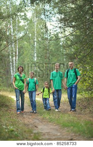 Cheerful family in green