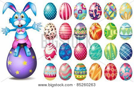 Easter bunny and many painted eggs