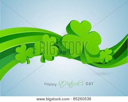3D shamrock leaves on green waves for St. Patrick's Day celebration.