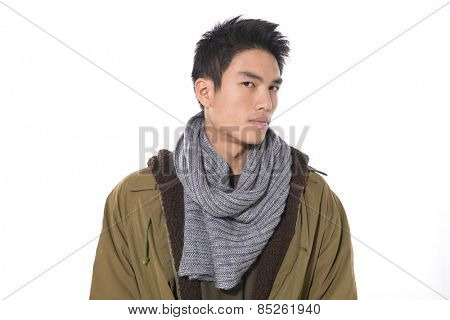 He is now a professional model- young man in coat. with scarf