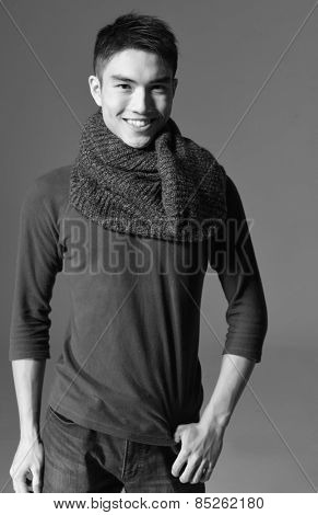 young smile man standing with hands in pockets posing