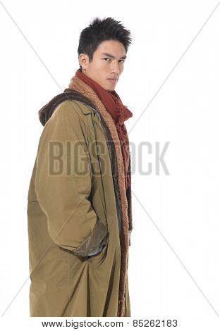 Fashion Shot of a young man in coat on white background