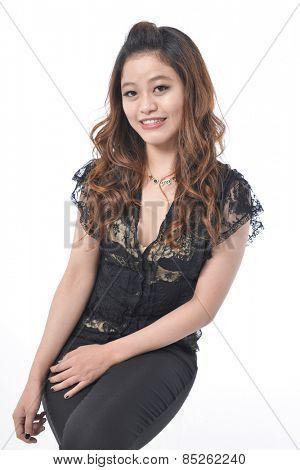 fashion portrait of beautiful young woman, sitting