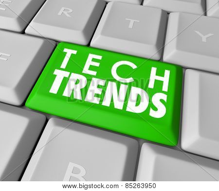 Top Trends words on a green computer keyboard button to illustrate top, best or most popular modern computer programs, software, hardware or devices