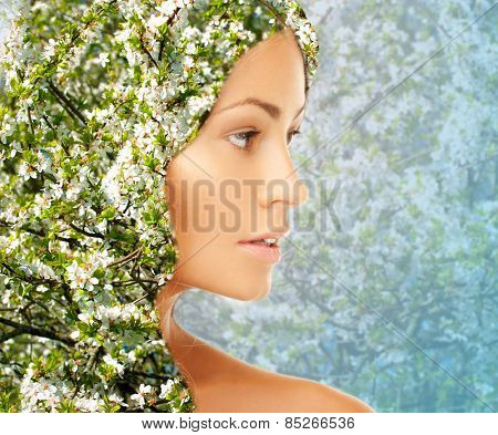 beauty, people, spring, summer season and health concept - young woman face silhouette over blooming tree floral pattern and double exposure effect