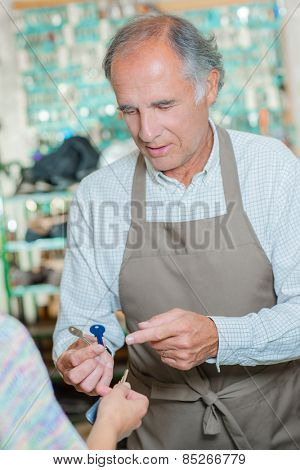 Man making replacement keys