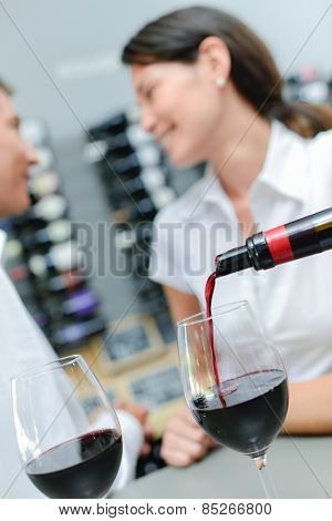 Pouring wine  for a couple