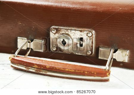 Old wooden suitcase on wooden background
