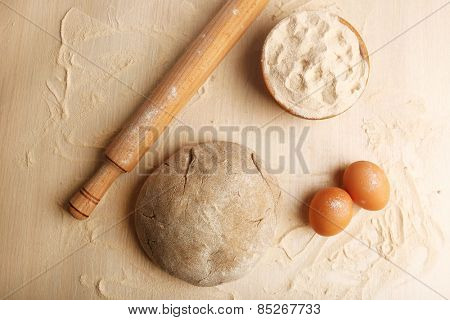 Making bread on wooden table background