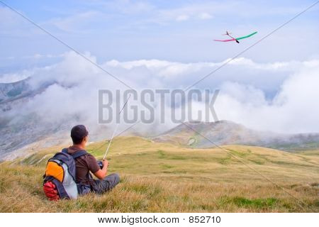 Man flying a plane from a top of the mountain