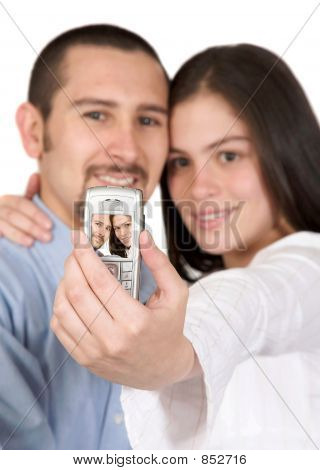 casual couple taking a pic with their mobile
