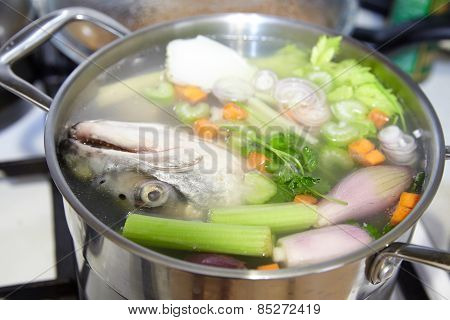Cooking  fish broth with vegetables