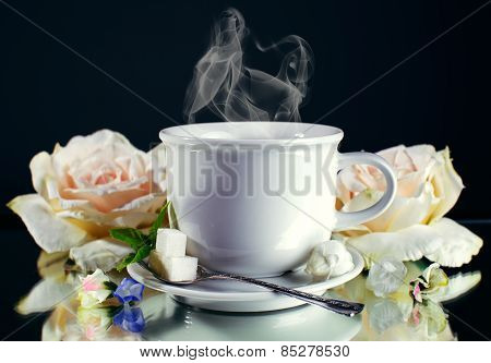 Cup Of Hot Coffee With Steam On Dark Background